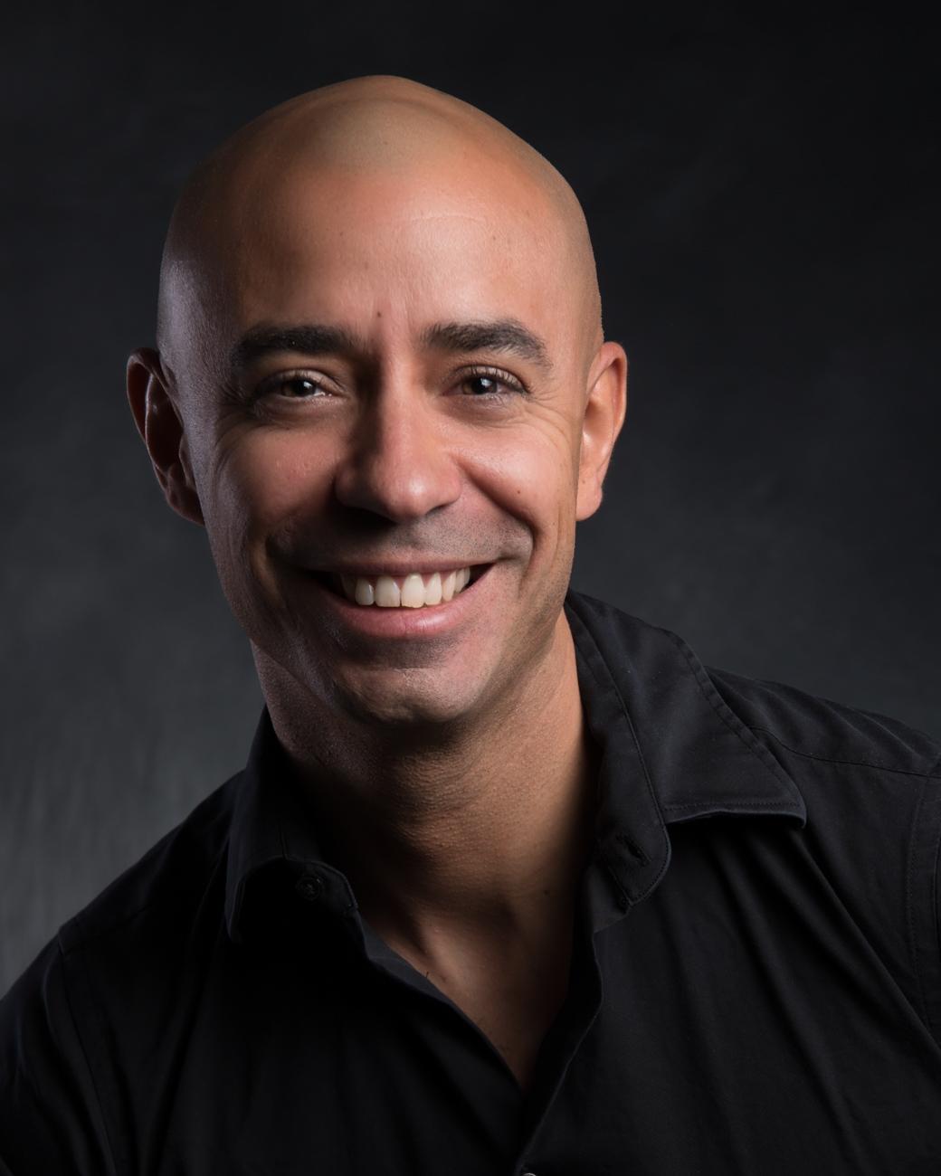 studio headshot of a smiling man for professional branding