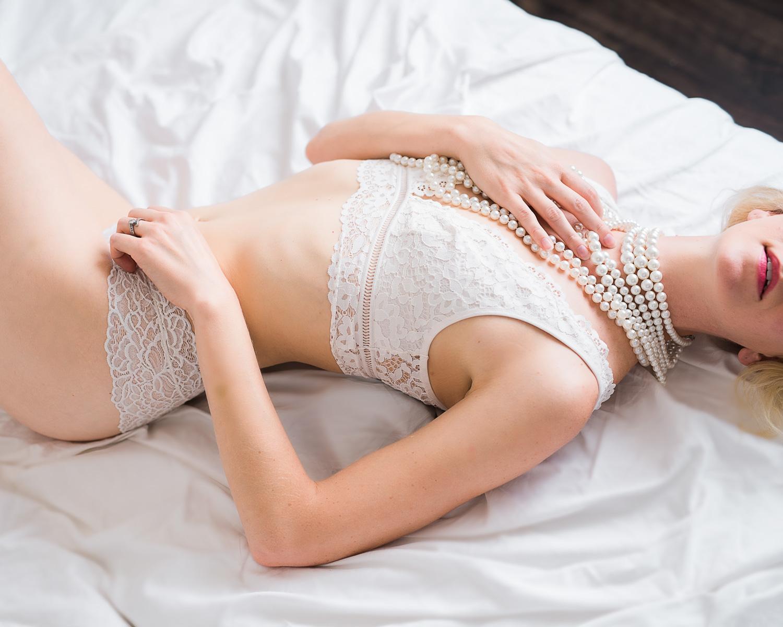 Bridal boudoir photo idea white lingerie and pearls