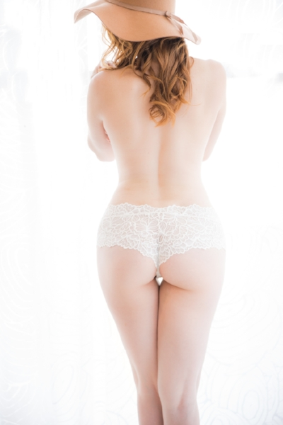 White cheeky panties, brown hat and red hair  Photo by Martina Zando Photography