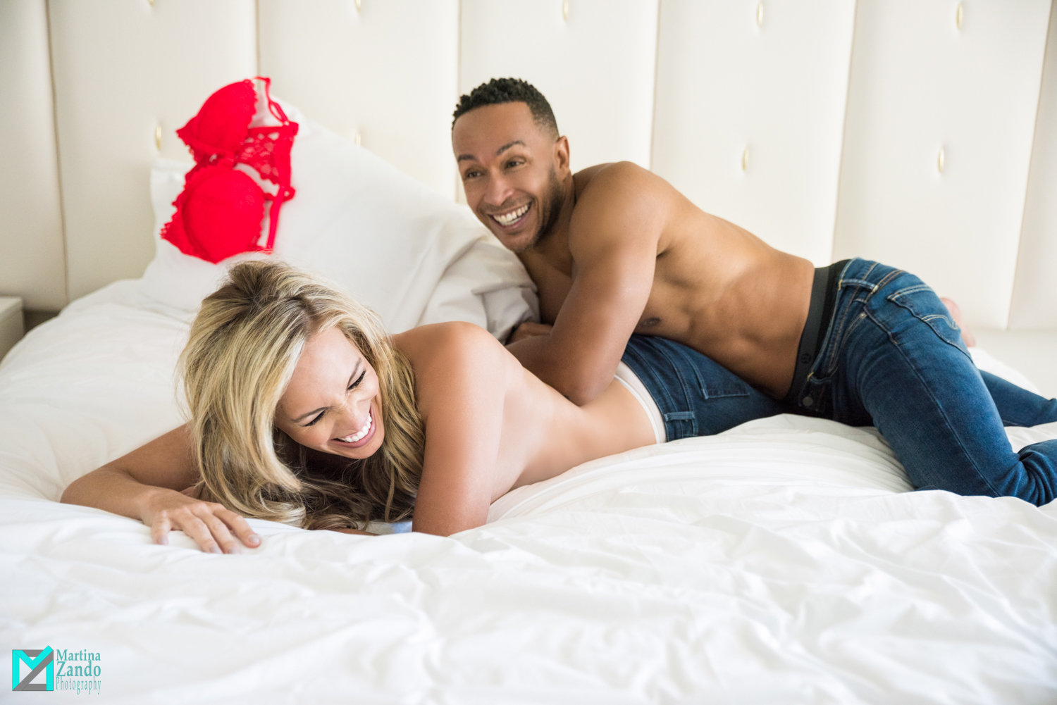 playful couples boudoir on white bed