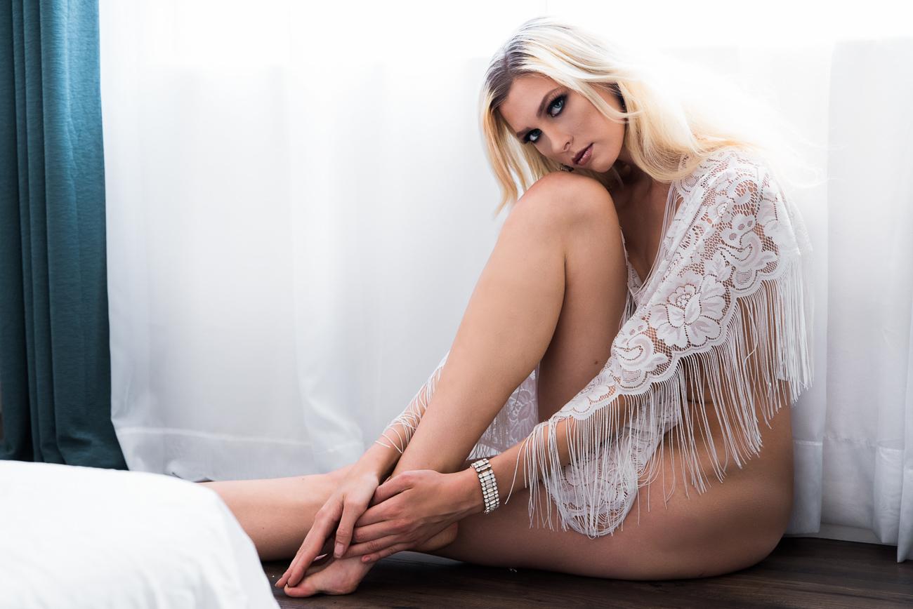 bohemian boudoir model with white lace top