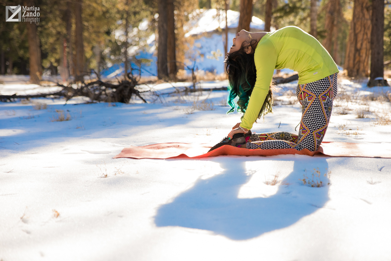 yoga instructor back bend in snow