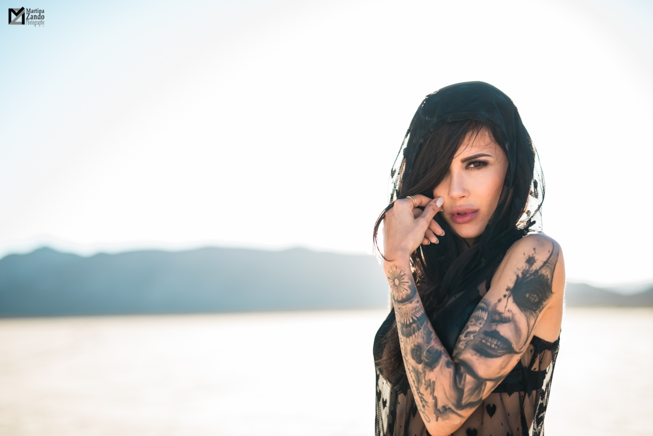 Naty Ashba in desert with tatoo sleeve