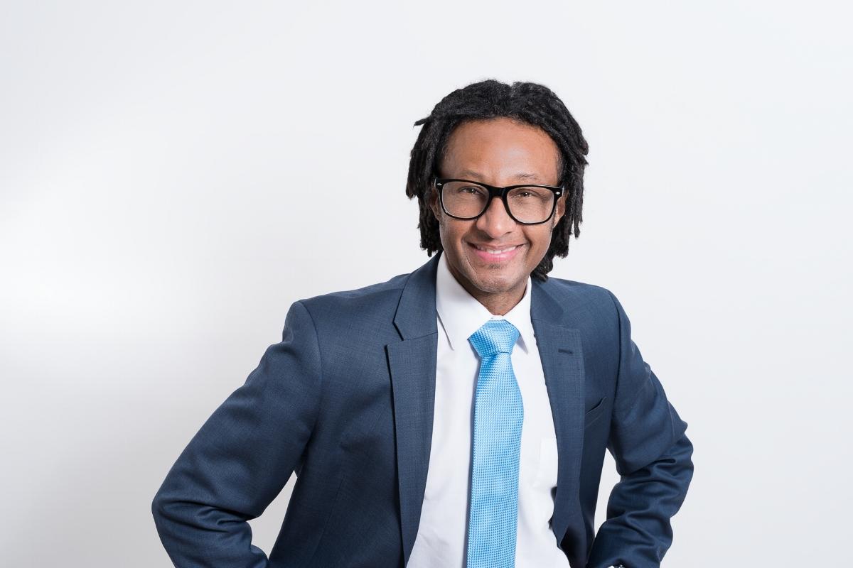 lifestyle portrait of Vital Germain, keynote speaker, entrepreneur for business branding
