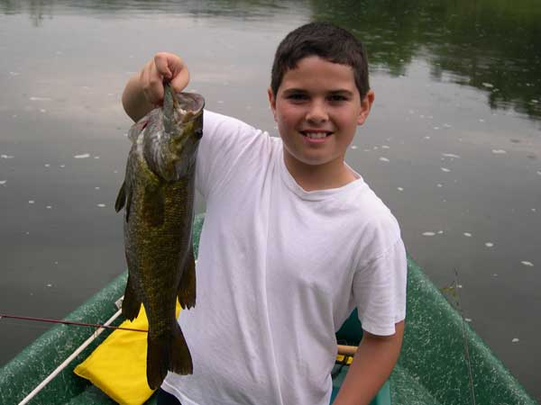 """Dane with a lunker 20"""" Smallmouth Bass on this summer day!"""