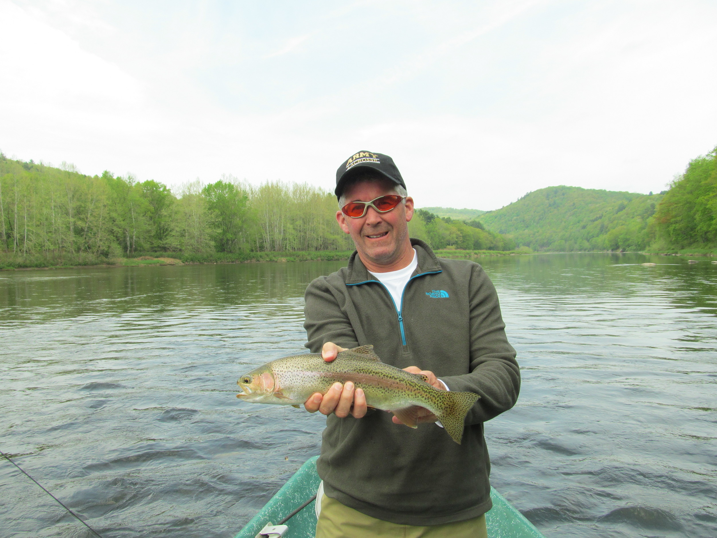 Greg B. with a beautiful upper Delaware wild rainbow about to be released!