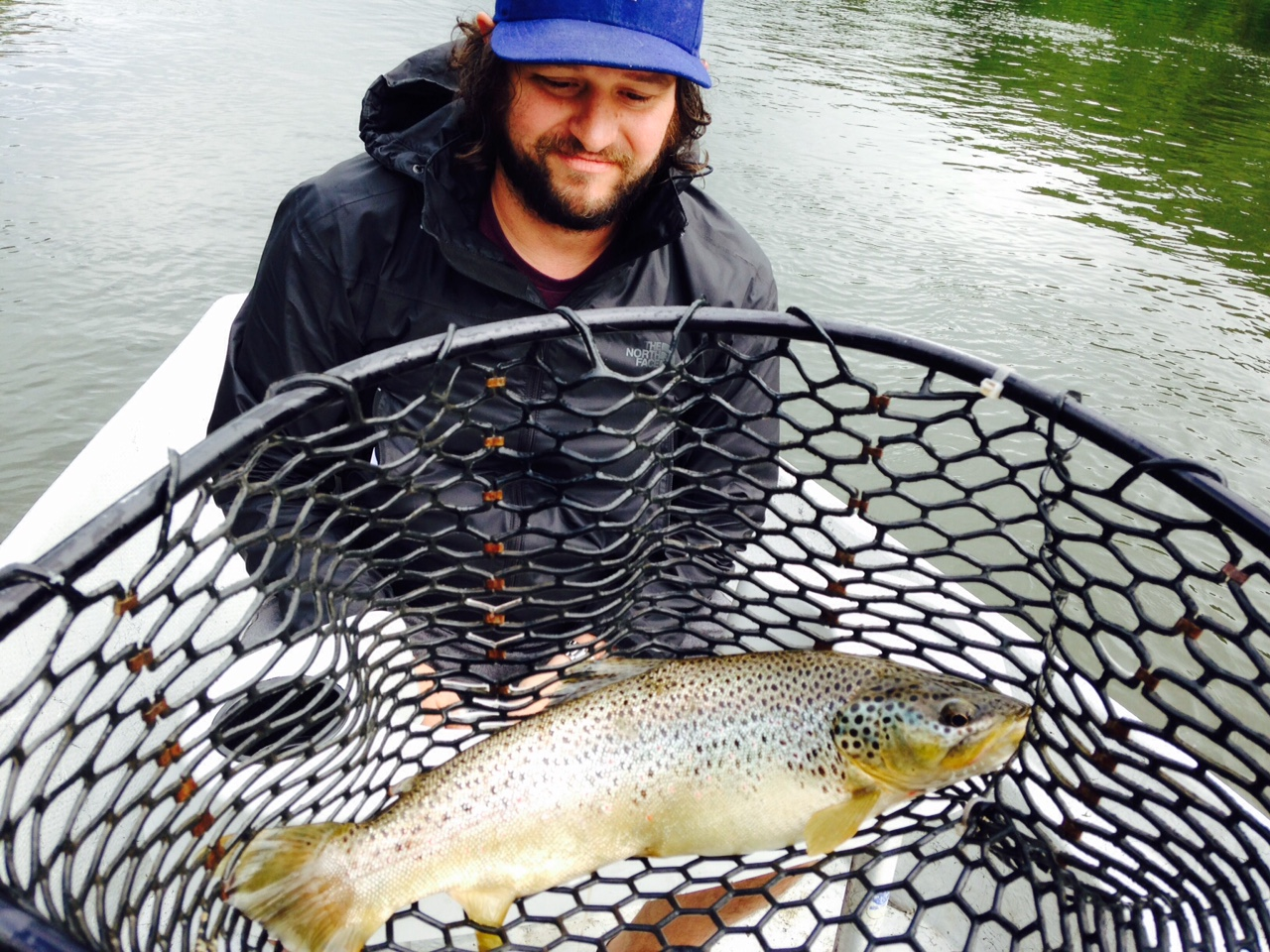 """Ian with a Fat 17"""" Brown trout in the net!"""
