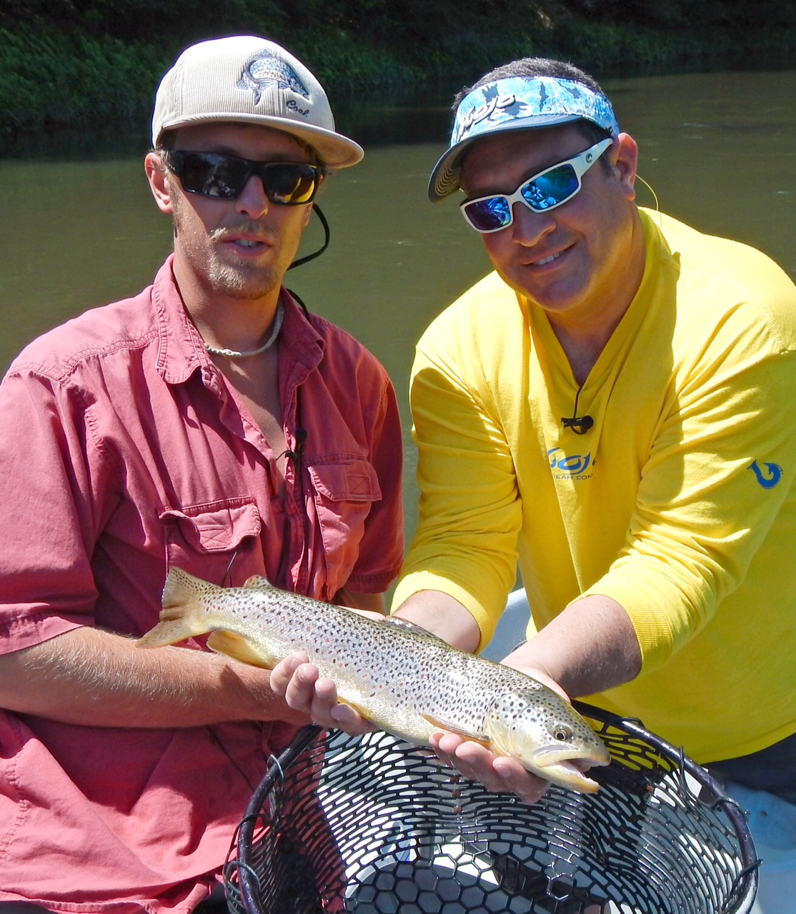 """Capt. Joey leggio and Guide Evan P. display this 19"""" Brown trout"""