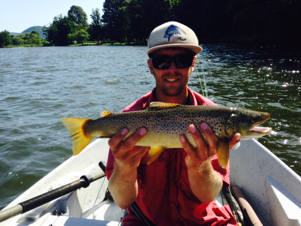 "7/3/15 Guide Evan P. connects with this mean looking 19"" Brown trout"