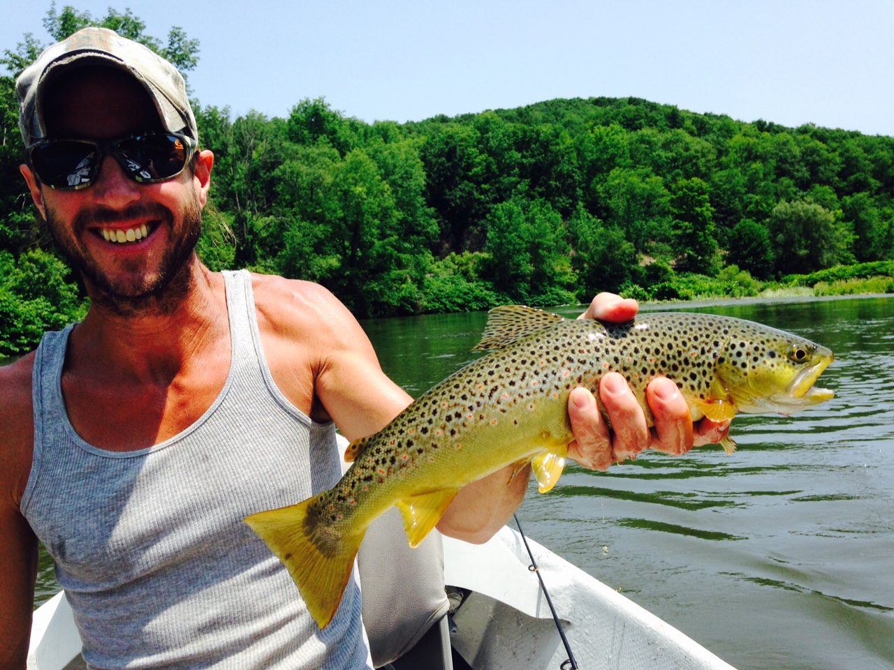 "7/3/15  Matt holding this beautiful 17"" West Branch Brown trout!"