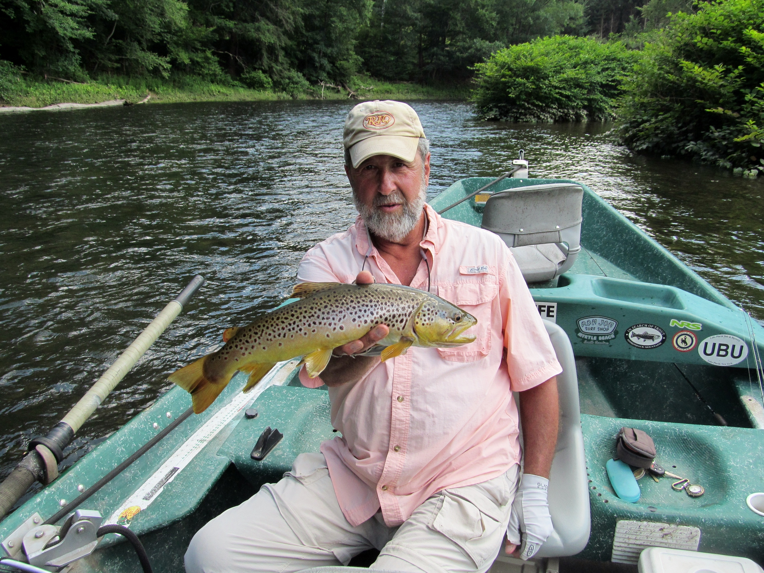 """7/10/15 Guide Mike P. Holding a nice 20"""" Brown trout"""
