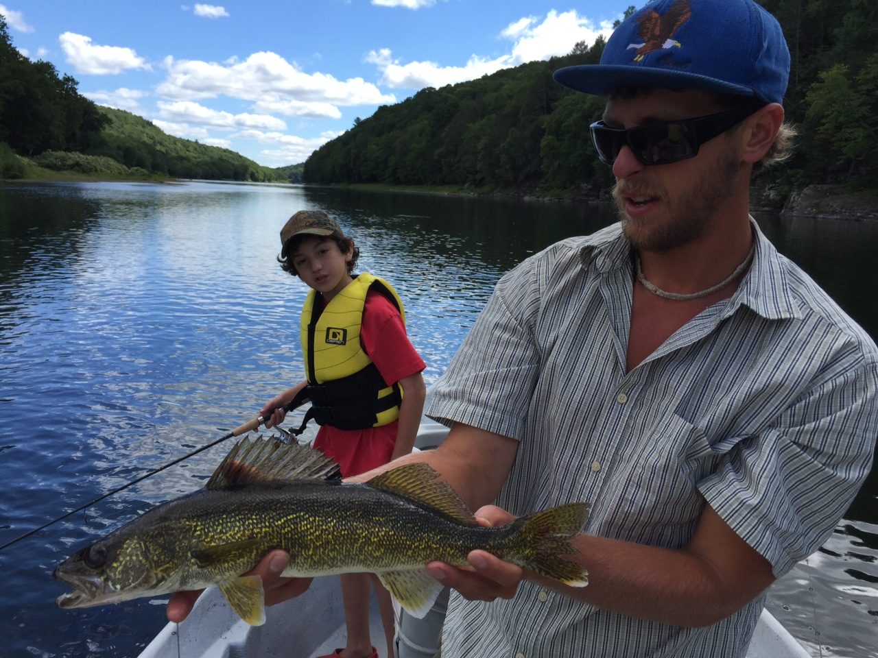 "8/28/15Jacob and Guide Evan displaying an 18"" Walleye"