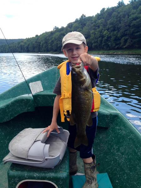 "Little Guy Reese with a Lunker 20"" Smallmouth bass"