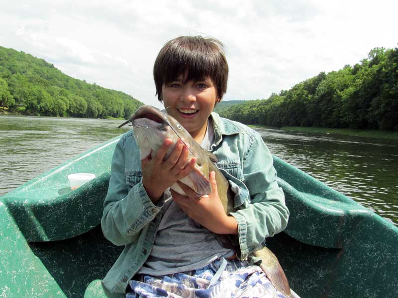 """Antonio with a 27"""" Channel Cat! Click Photo for More!"""