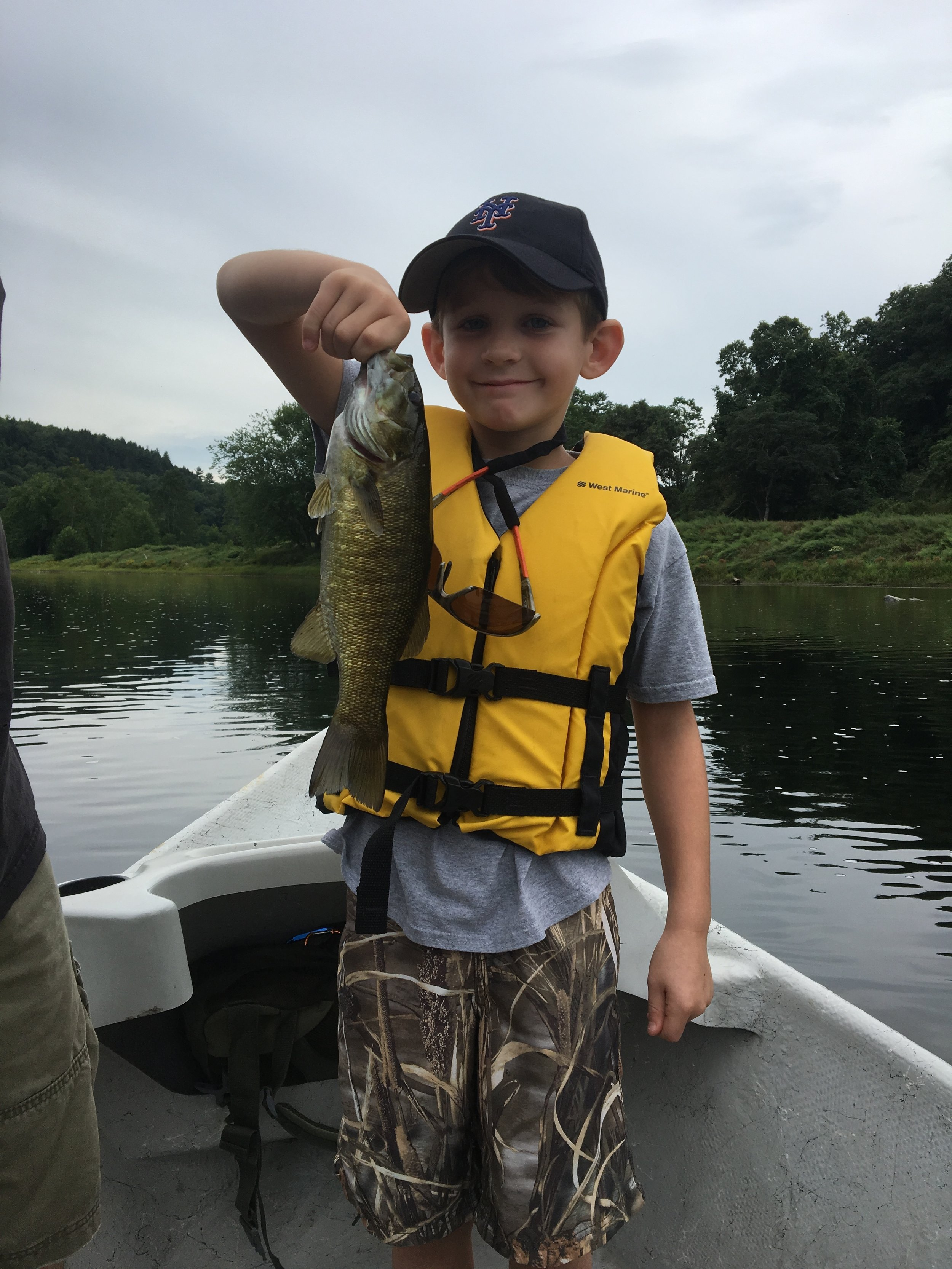 A young Mets fan gets a nice Smallmouth!