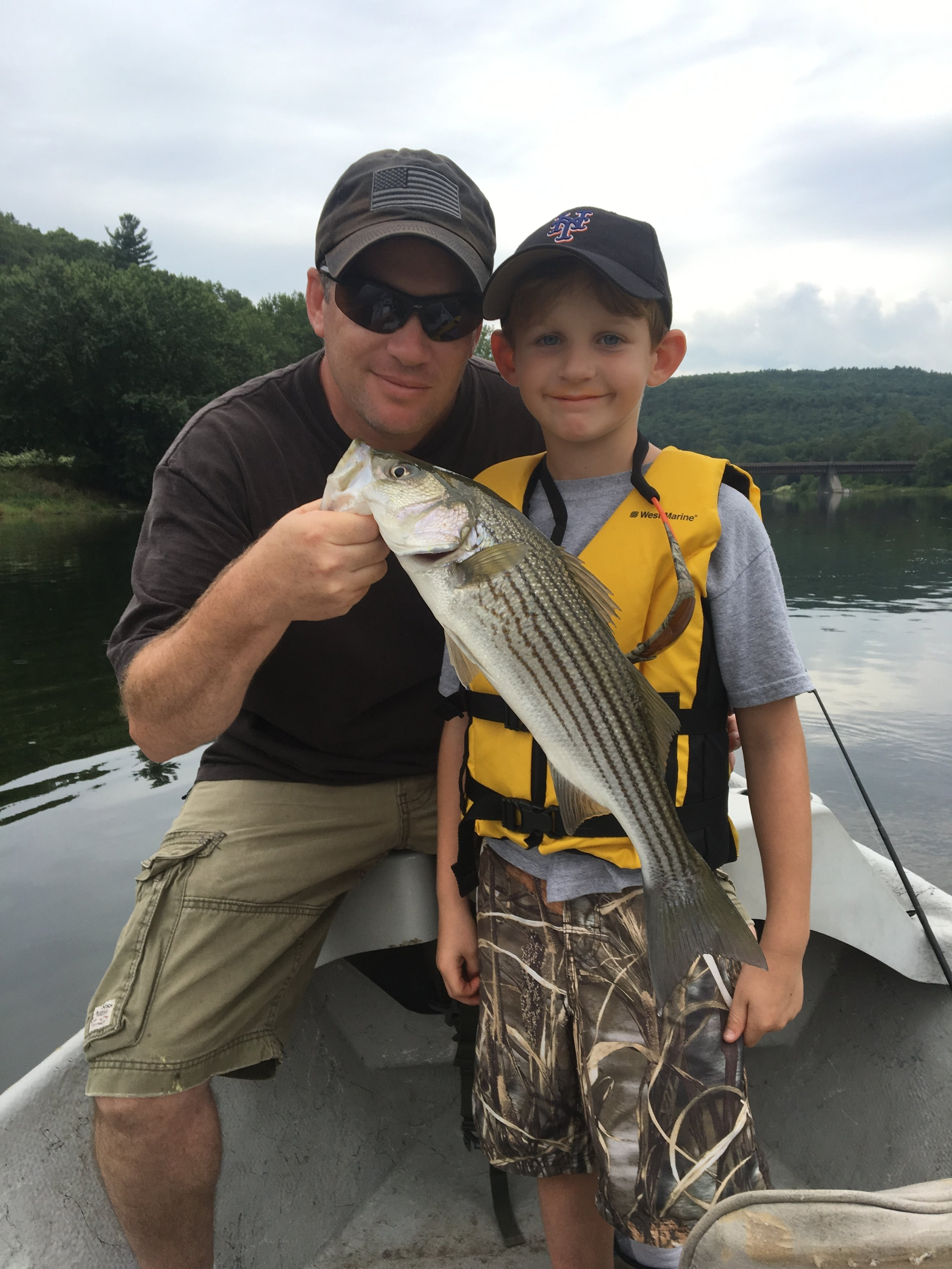 """A nice 21"""" Smallmouth Bass for Rick L. and his son."""