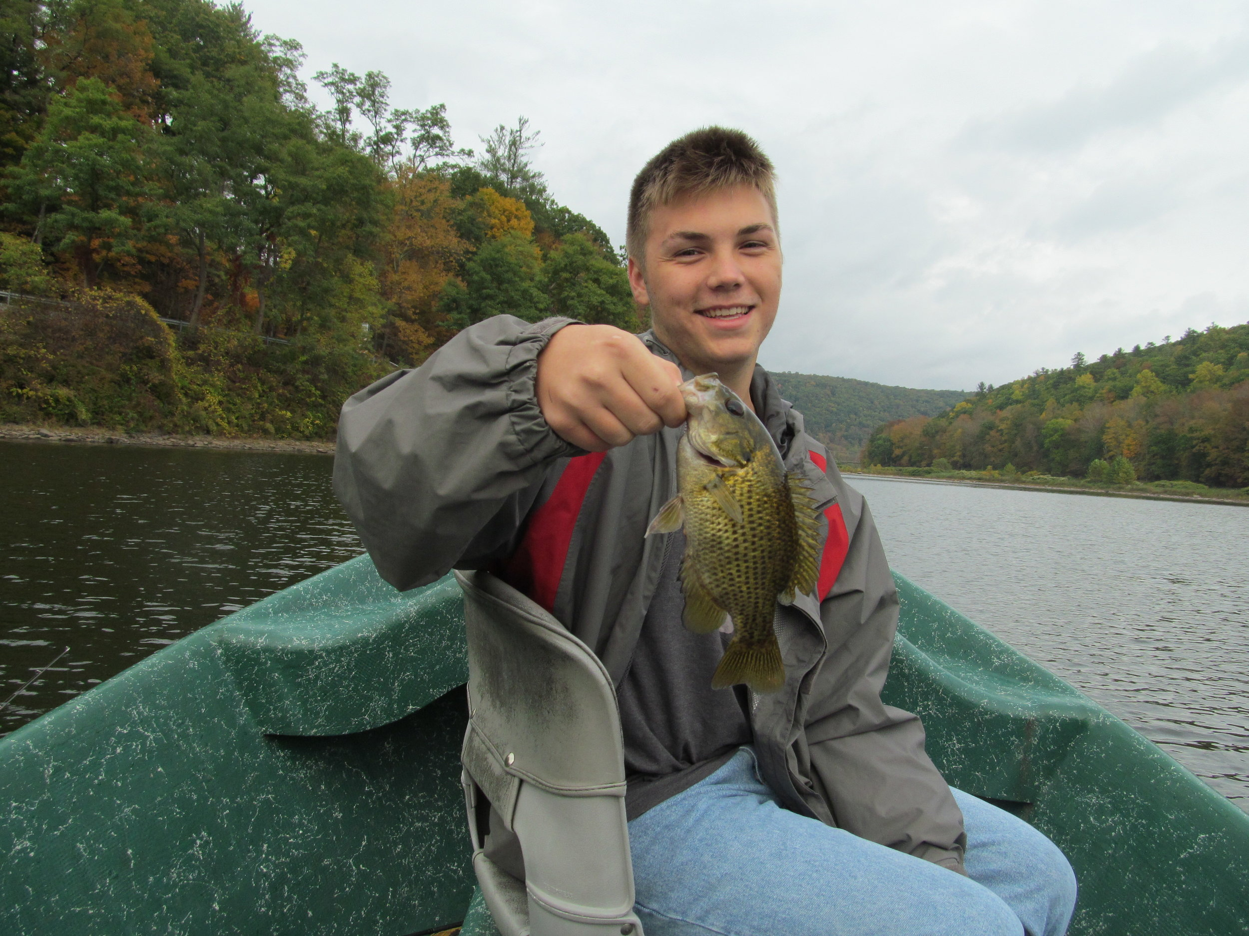 Nathan of the Eldred Fishing Club with a Rock Bass.