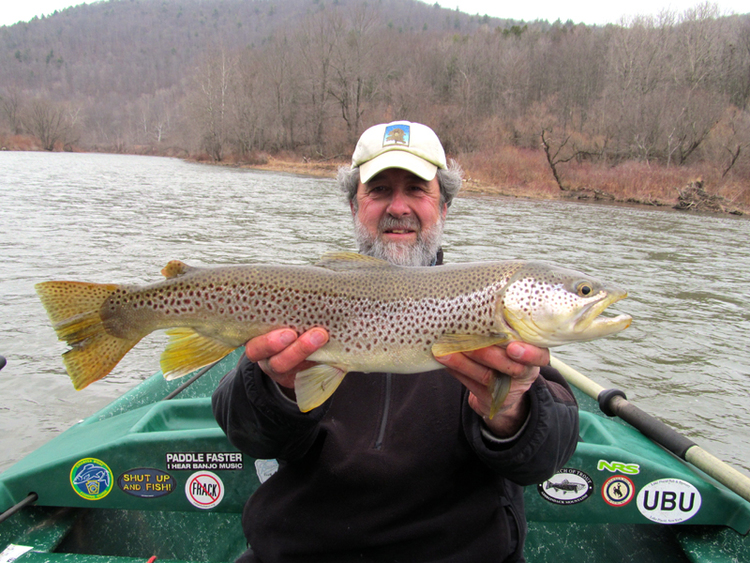Guide Mike P. with an early season two foot Brown Trout!