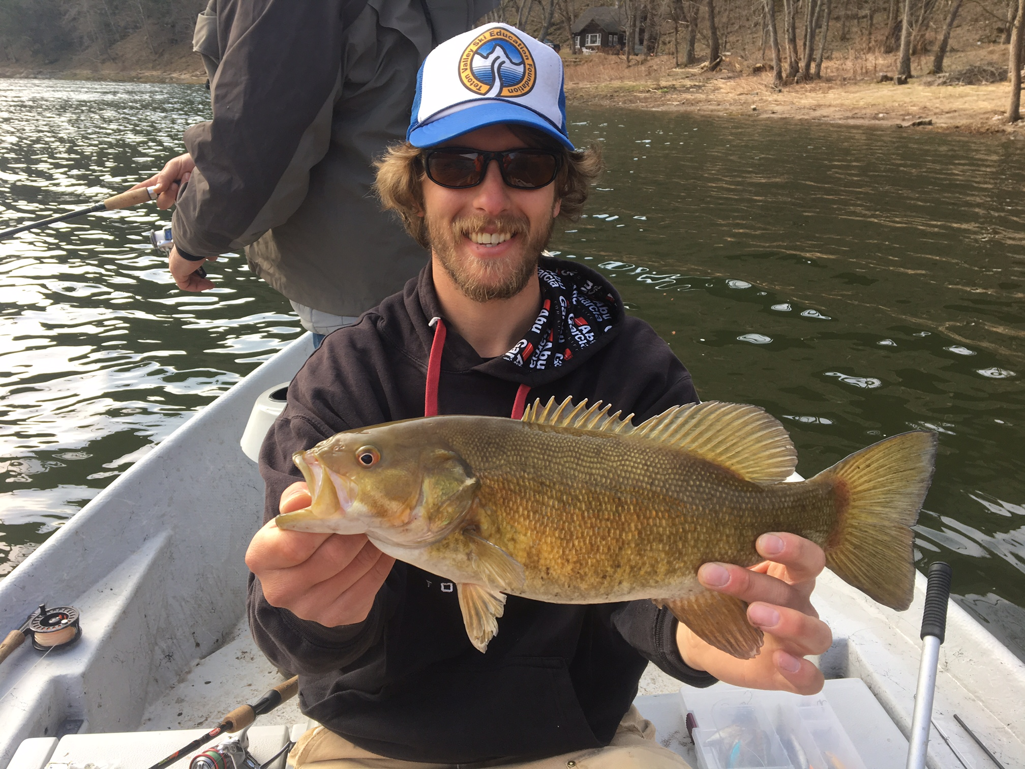 """Guide Evan P with a 17"""" Smallmouth."""