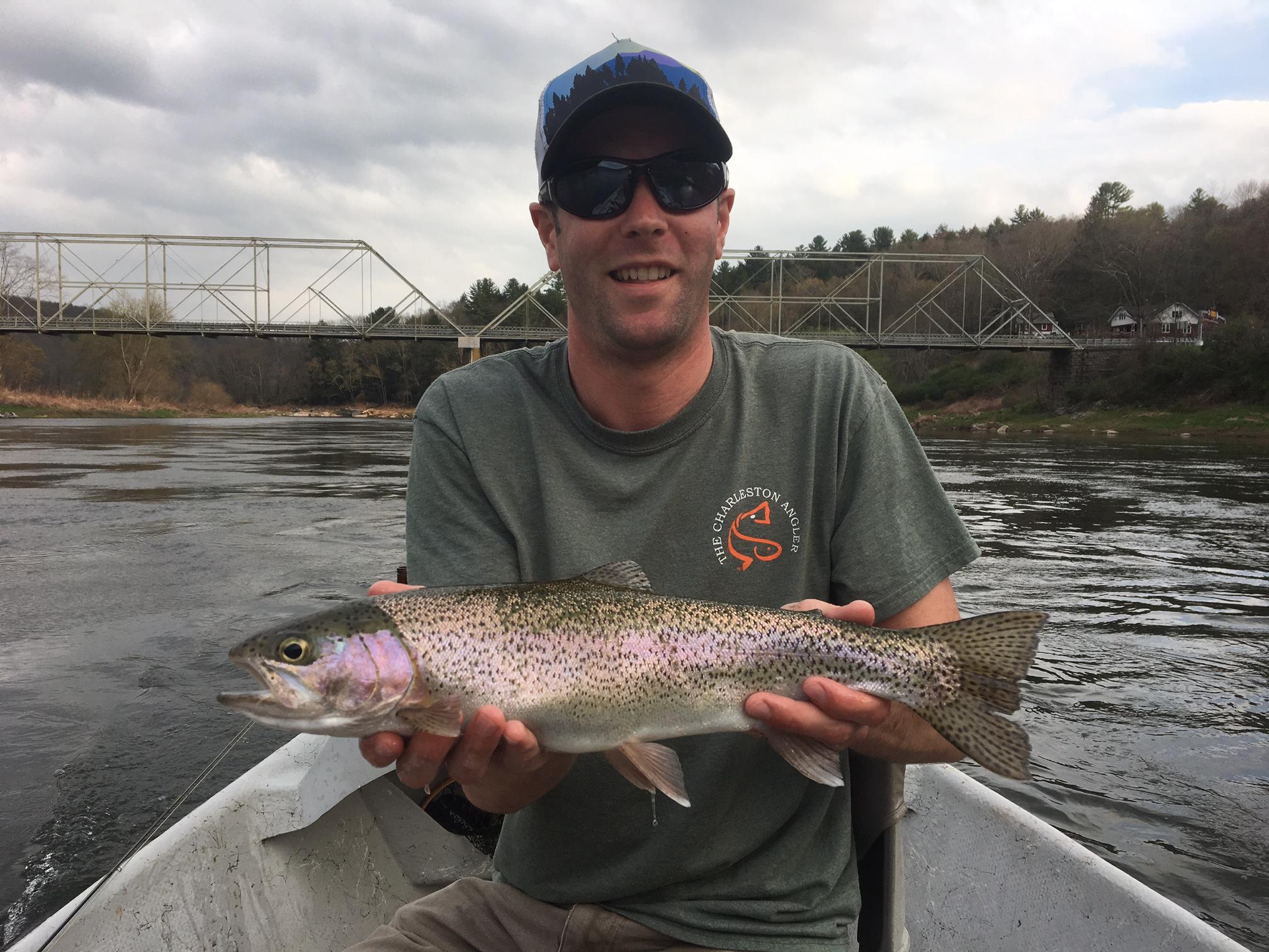 Kyle T. with a Slammer Rainbow on the dry fly.