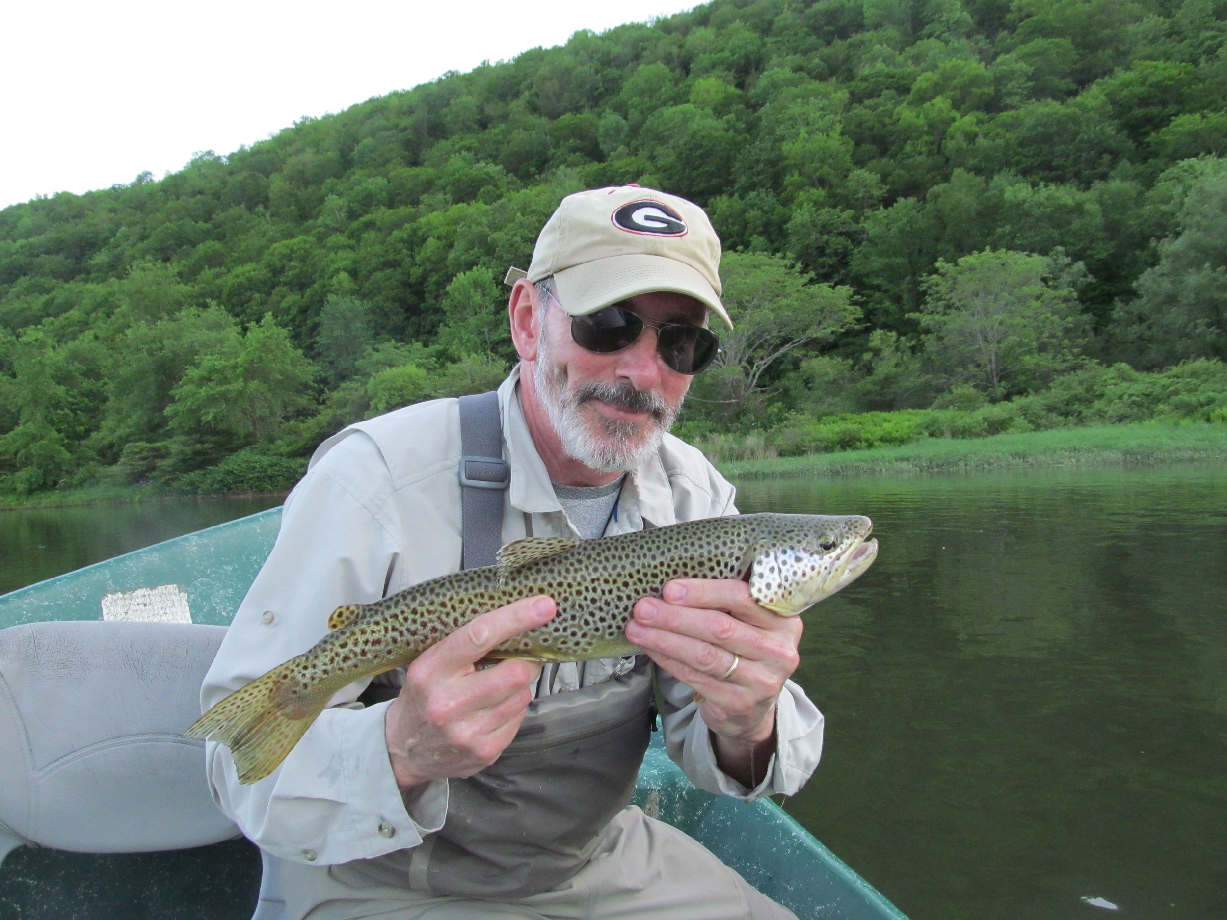 "Bruce S. with a 20"" brown on a dry fly."