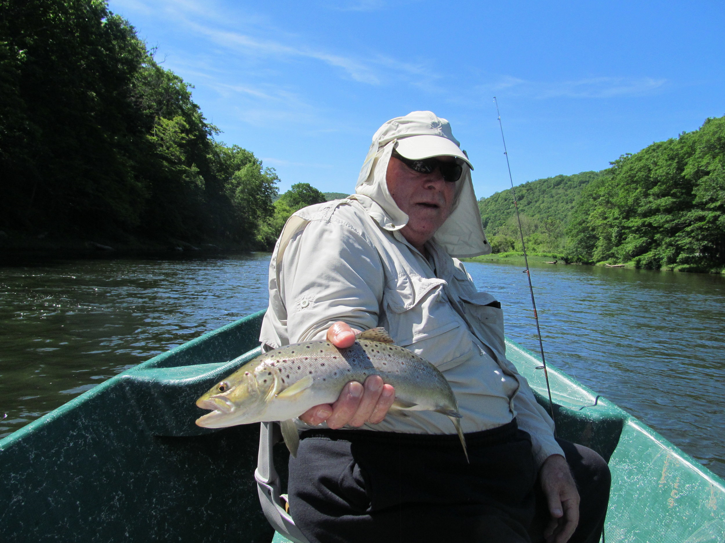 Tom G. holding a prize West Branch Brown trout.