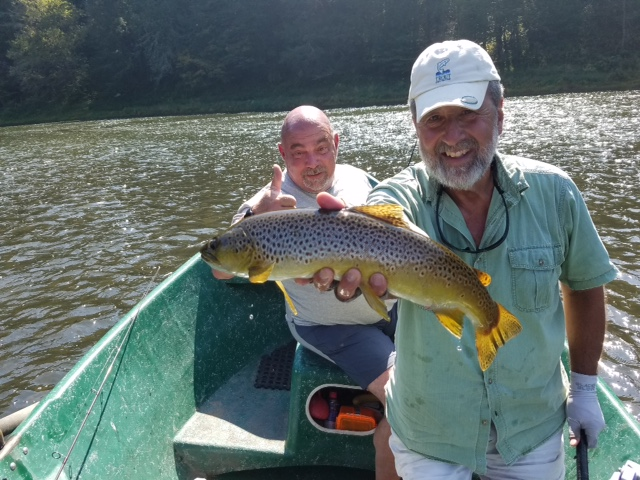 """Mike P. displaying a 21"""" Brown caught by Steve."""