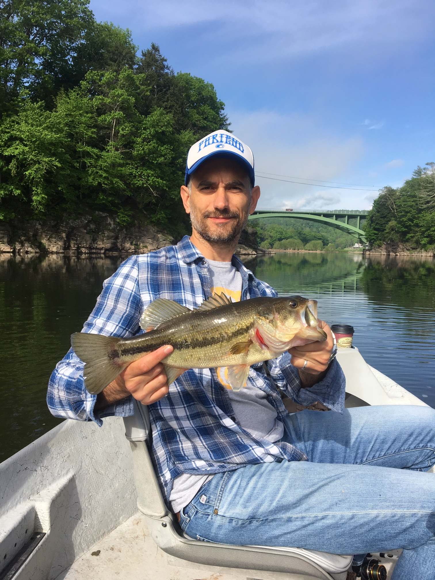 Adam with a rare Largemouth bass in a familiar spot