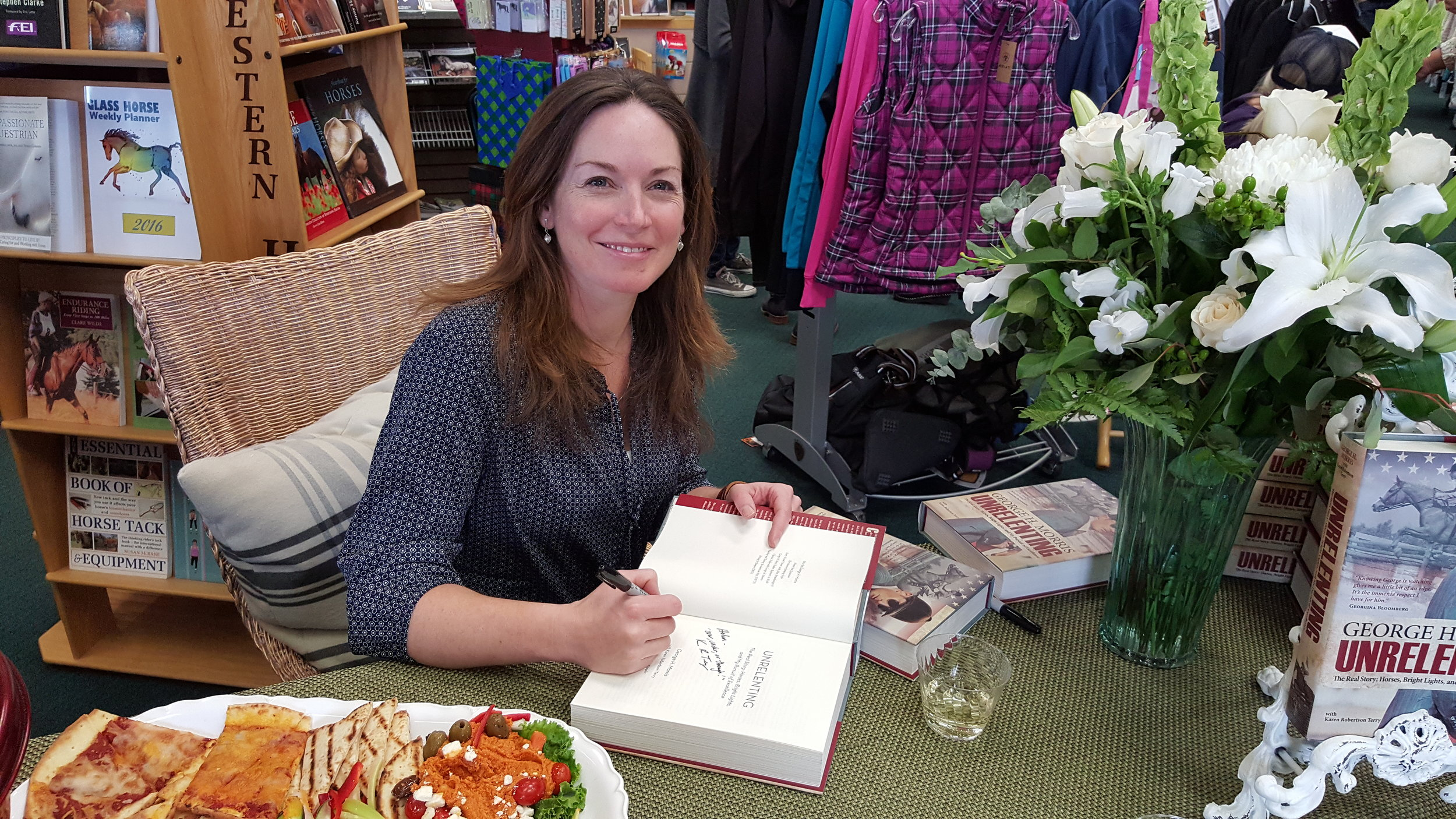 Karen Robertson Terry signing our copy of UNRELENTING.