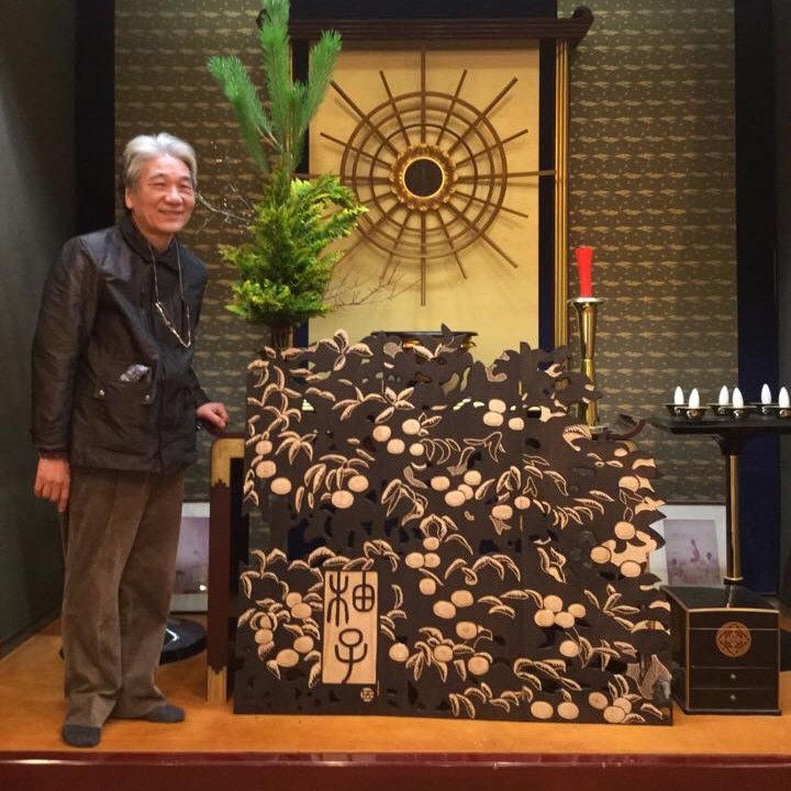 Sat san with YUZU tree, the artist of the wood carving artworks.