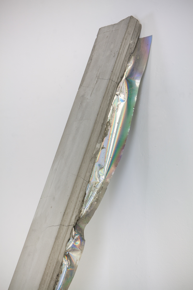 2x4, 2016  Cement, rebar, plastic mirror film. 7' long.