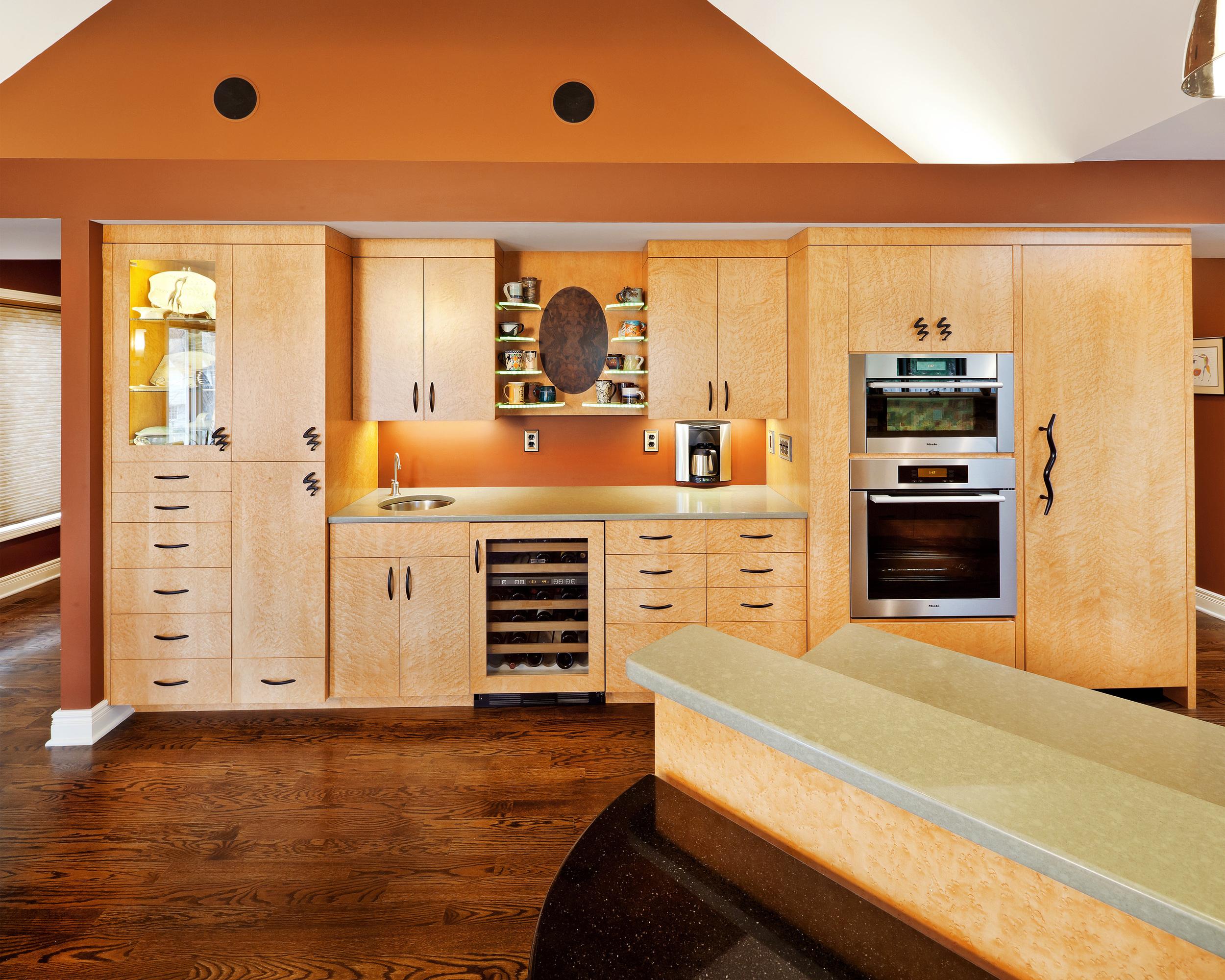 Bird's-eye maple cabinets in custom European-style flat fronts.