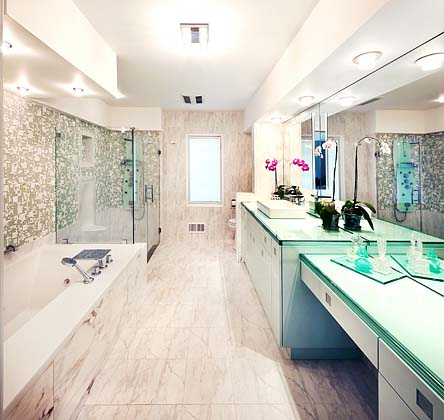 Master Bathroom with a floor to ceiling shower spa and luxurious built in jetted bathtub.