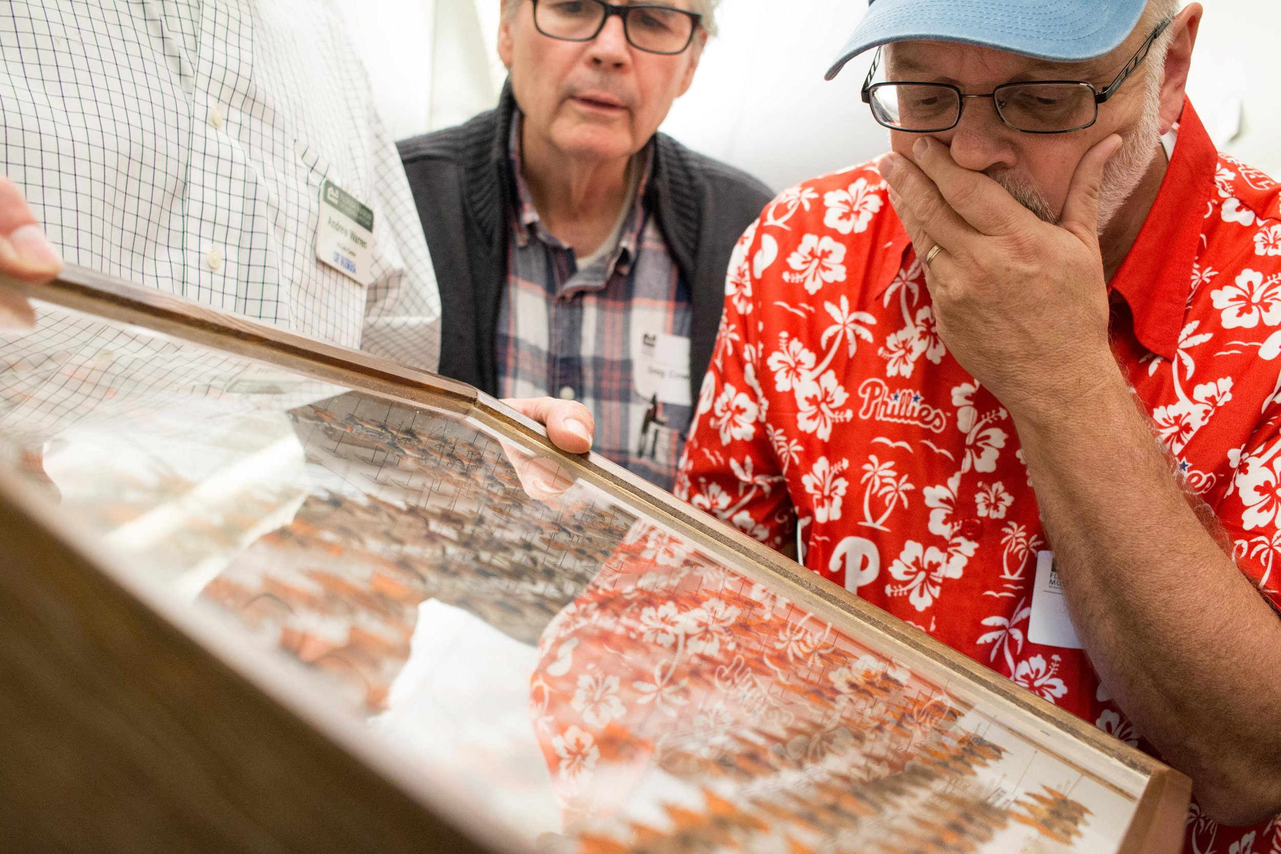 Dr. Jon Gelhaus and Mr. Greg Cowper of Entomology Department at the Academy of Natural Sciences examine a drawer of butterfly specimens at the McGuire Center for Lepidoptera & Biodiversity at the University of Florida.