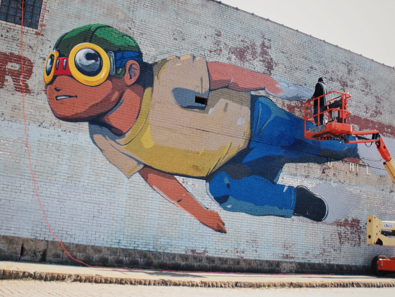 Hebru Brantley painting his Flyboy mural - photograph by Alex Young
