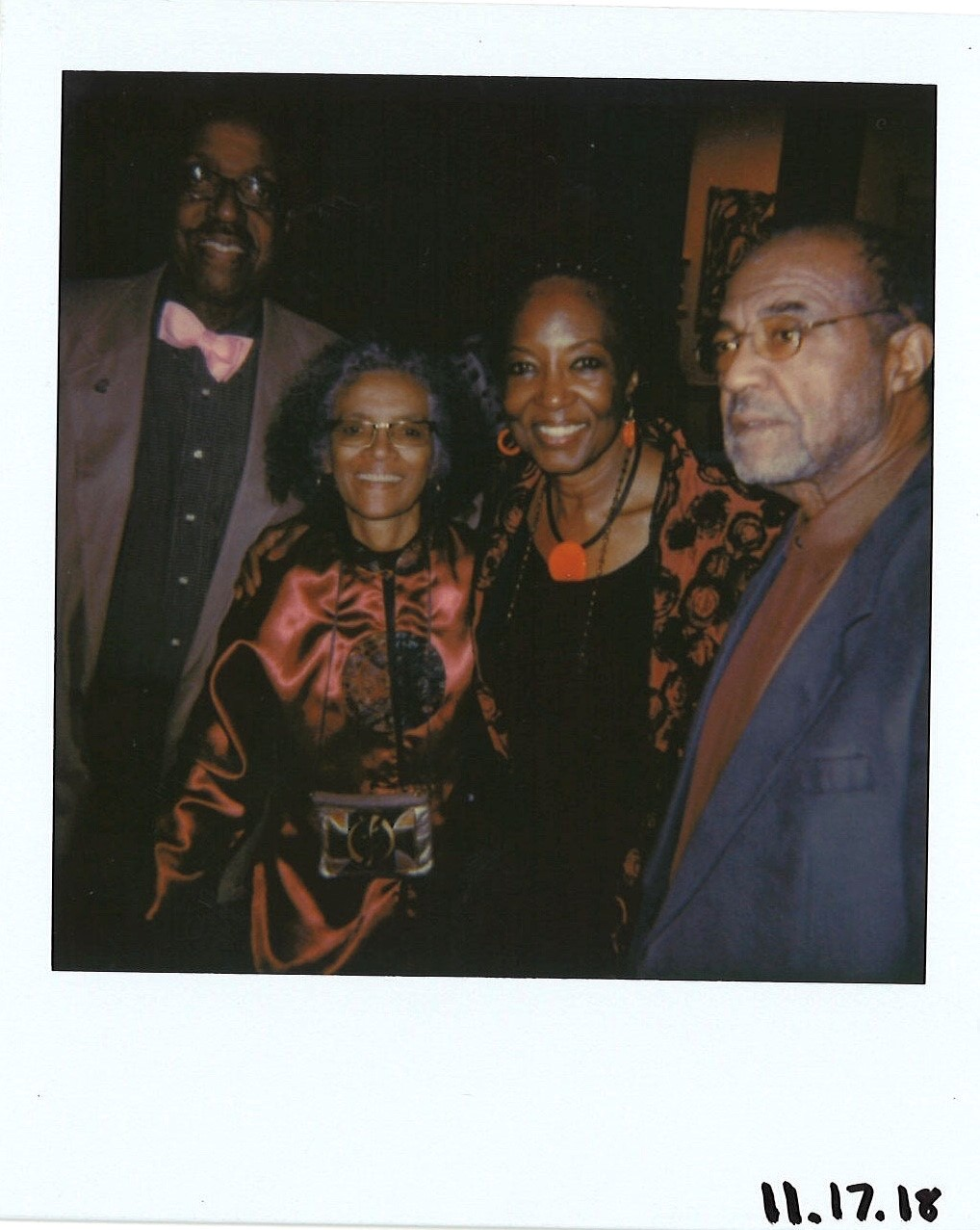 Oscar Cole pictured far right and members of Millennium Arts Salon. Polaroids by Maxwell Young
