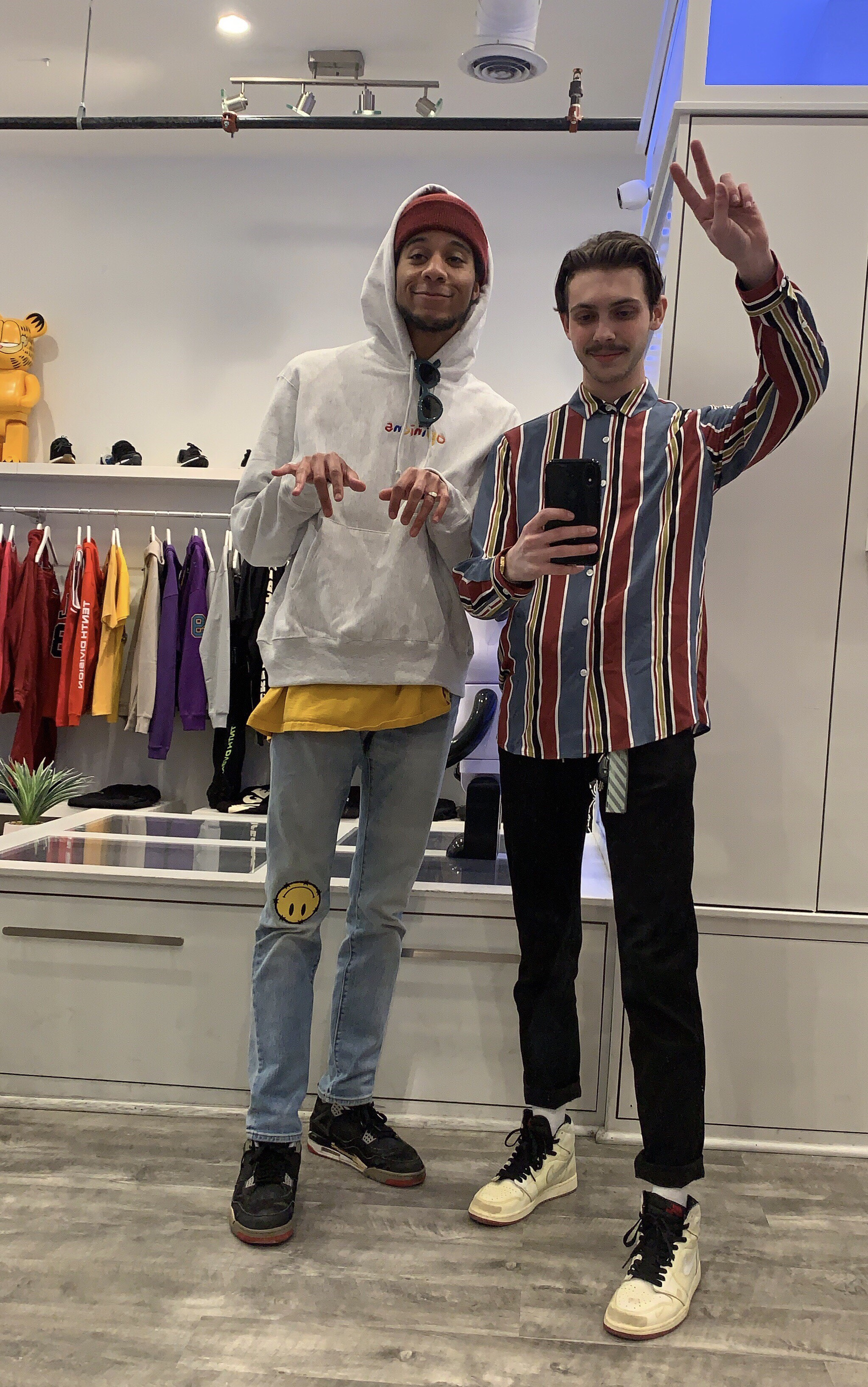 Alex Young (left) and Tyler Calpin (right) in front of the infamous fit pic mirror at Social Status. | photograph by Tyler Calpin