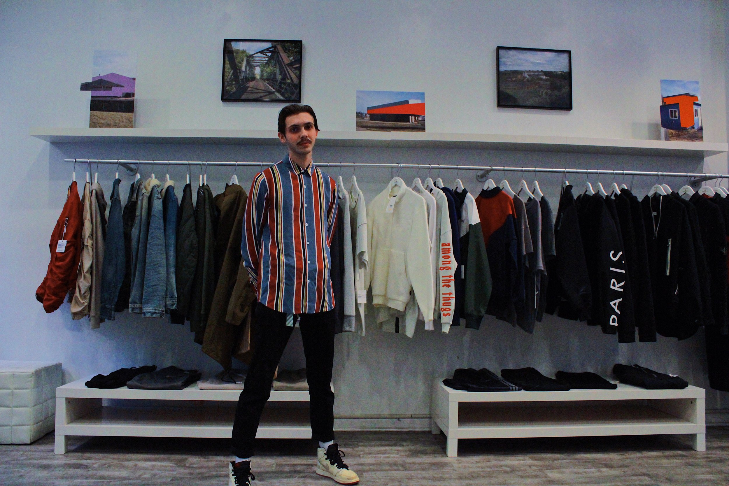 "Tyler Calpin standing in front of his pieces part of the ""Searching for Jenny"" exhibit at Social Status on Jan. 25, 2019. 