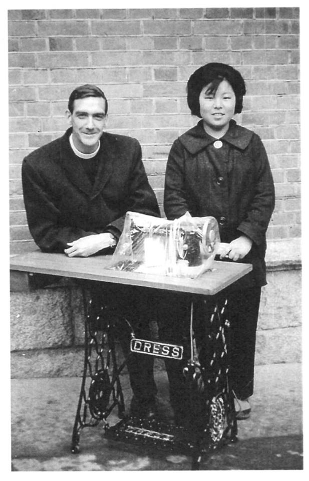 Rev'd David Cobbett presents a sewing machine to a graduate of the Pusan parish sewing school.