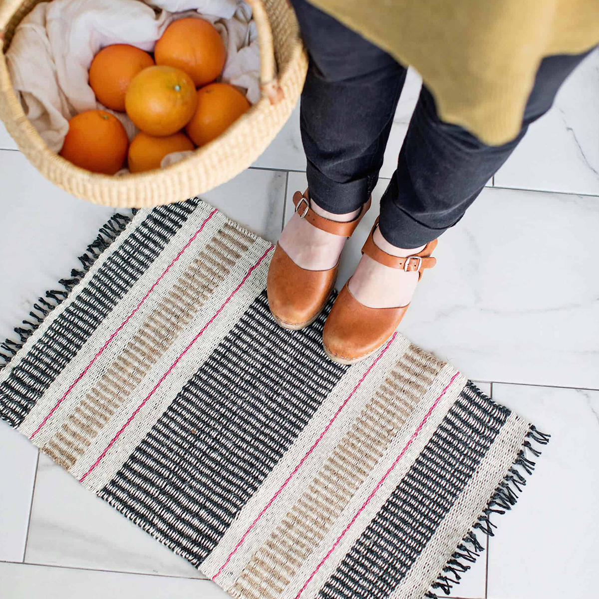 + A handmade jute mat - I said it before and I'll say it again, you can never go wrong with handmade gifts; especially when said gifts are both functional and beautiful. Give this DIY mat to the septuagenarian in your life and they'll be bragging to all their friends how talented you are and how proud you make them.(Image | A Beautiful Mess)
