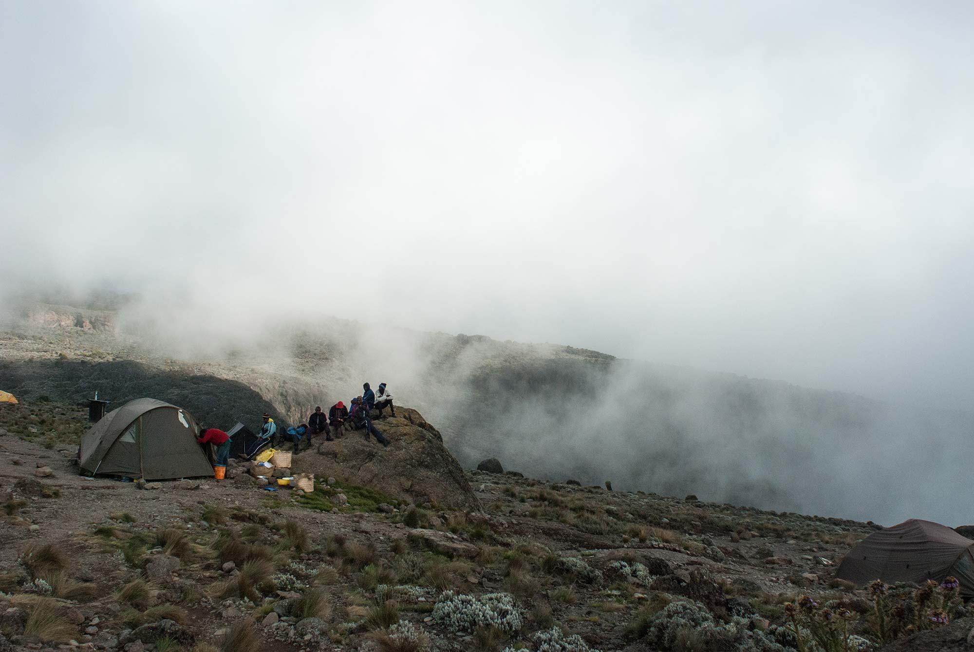 D5-16-porters-listening-to-soccer-on-a-rock-karanga-camp-kilimanjaro.jpg