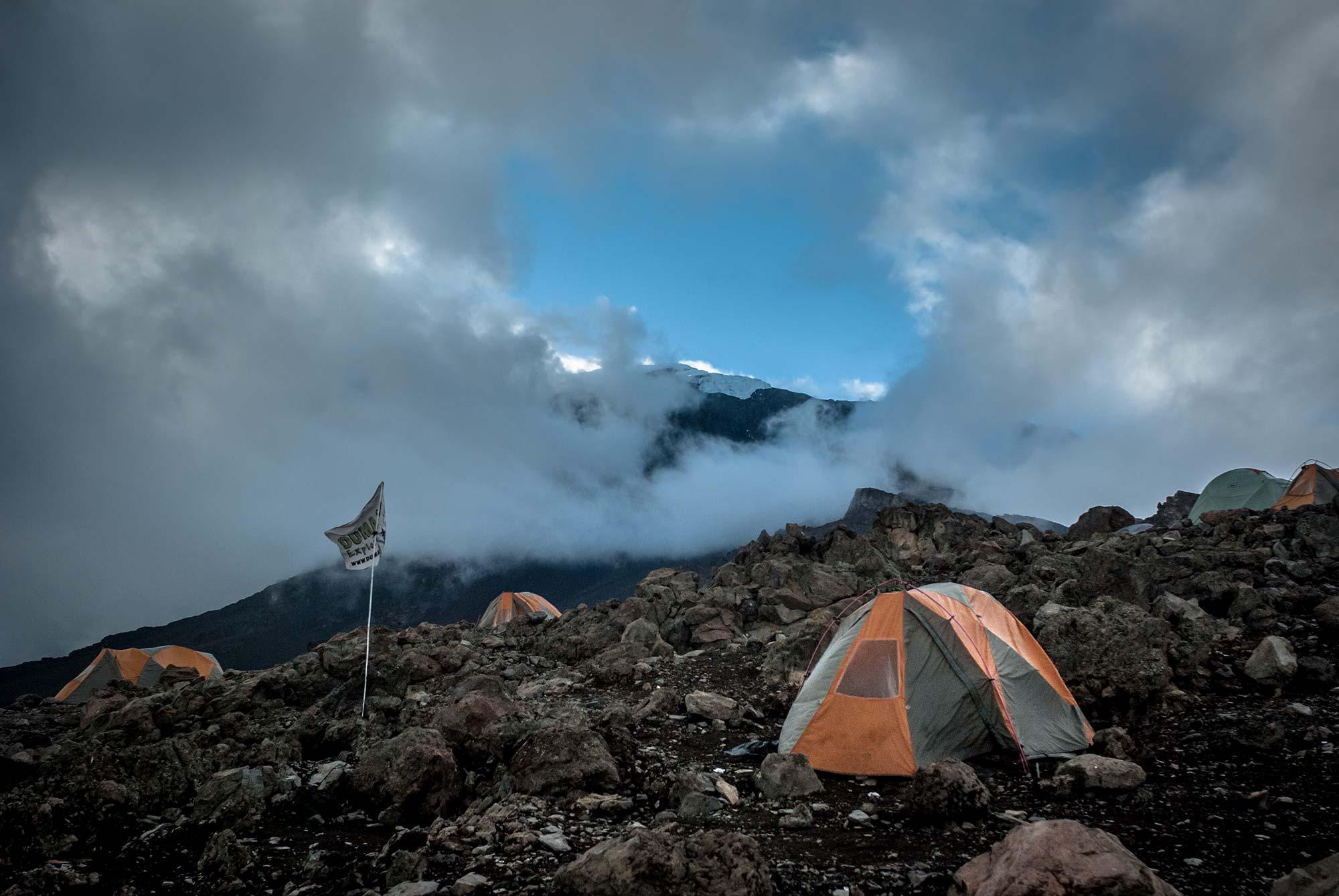 Duma Explorer flag whipping in the winds as the Sun sets over Barufu Camp, Kilimanjaro.