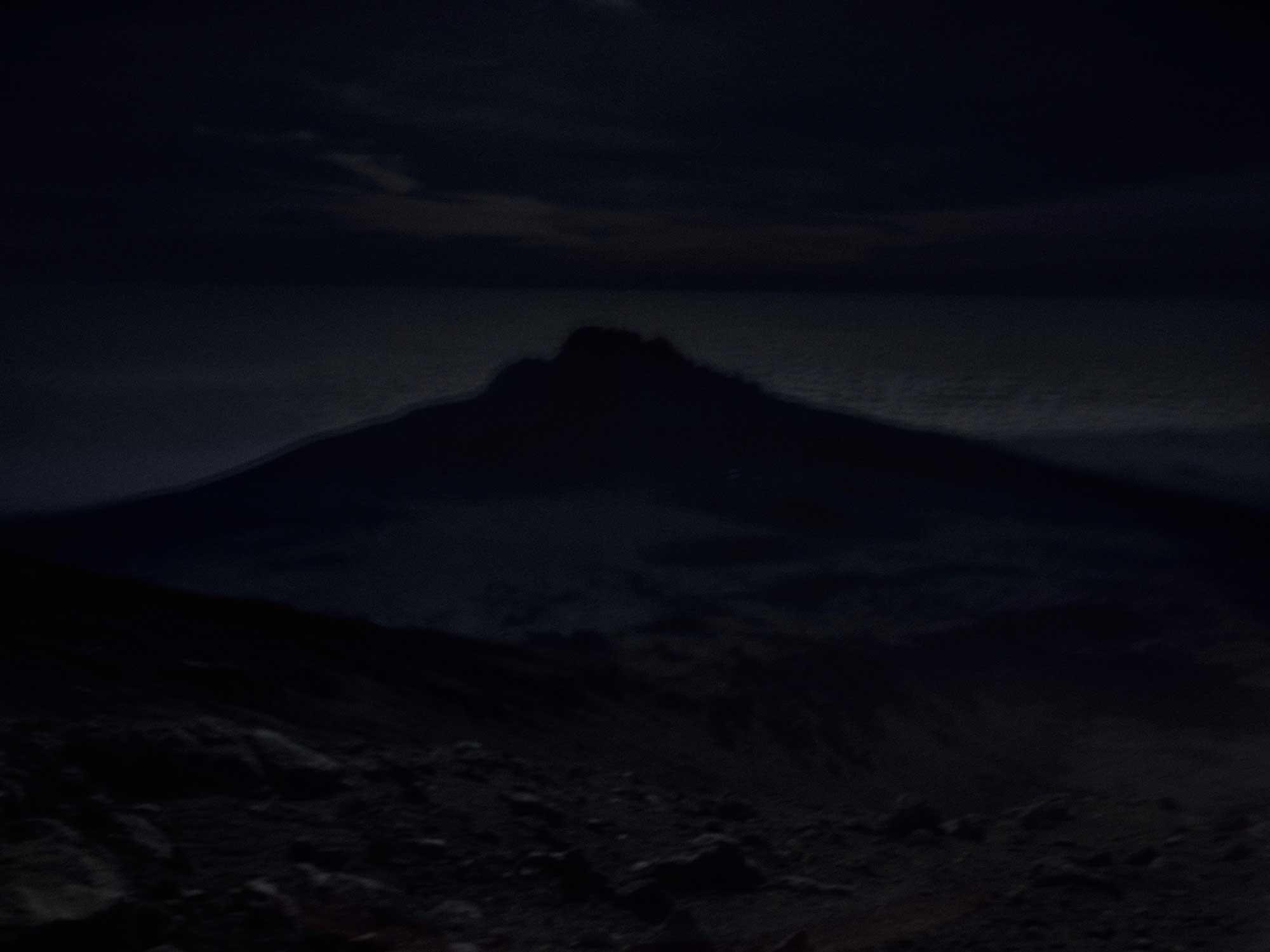 Mawenzi, a sister peak of Kibo sinks below the horizon.