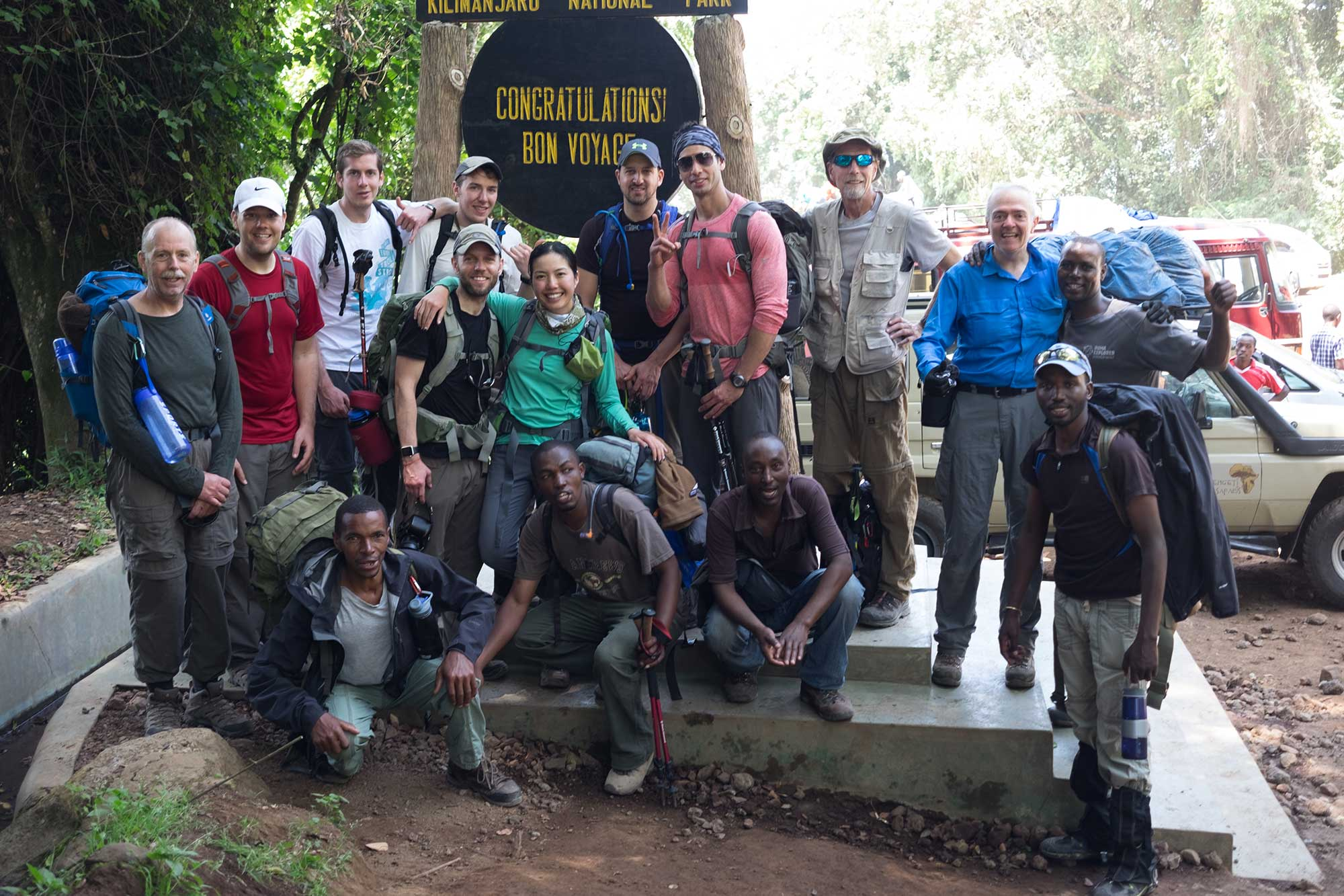 Climbers and guides celebrating a successful Kilimanjaro expedition.