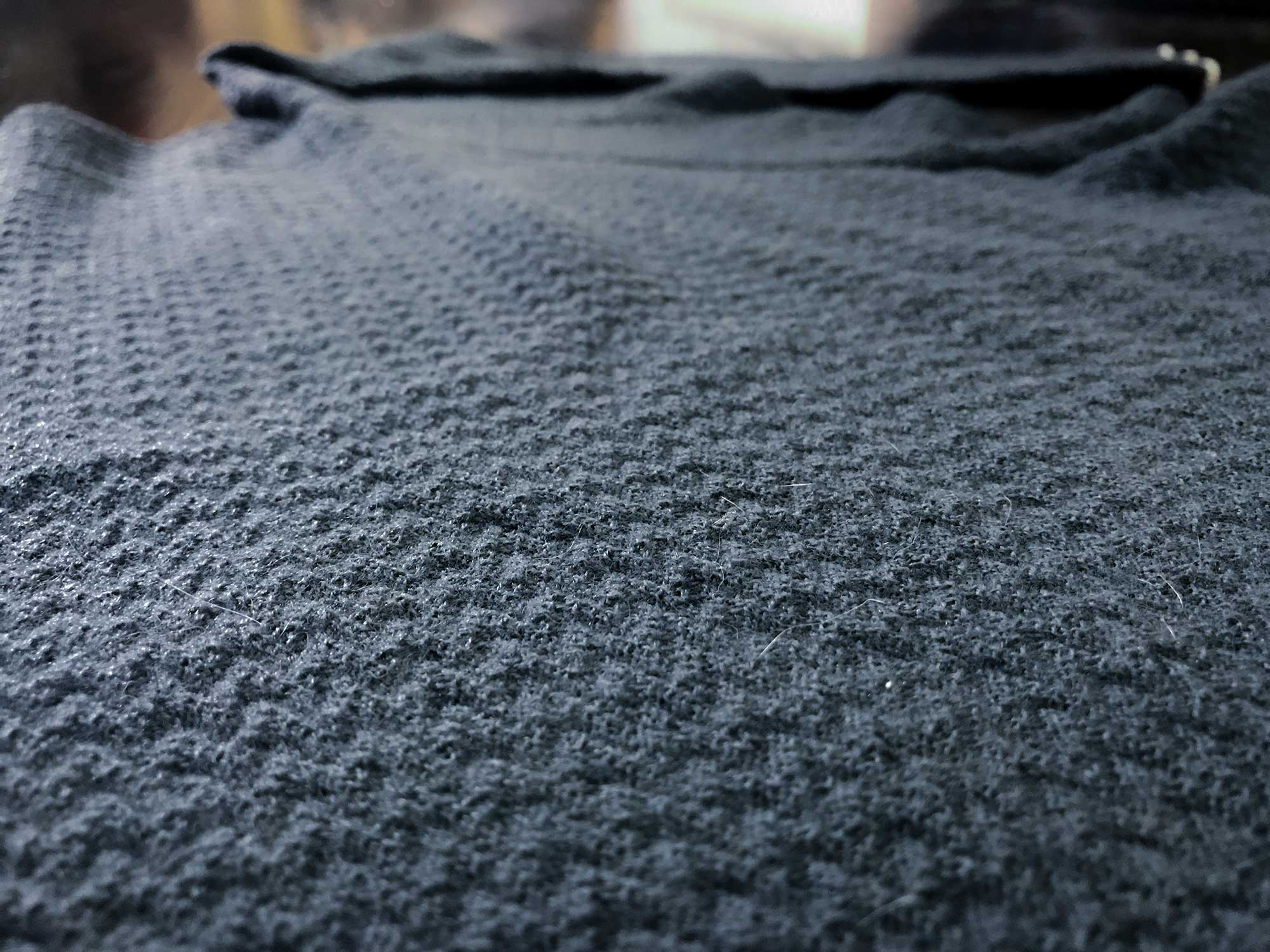 Patagonia's Merino Air weaves merino wool—that has been blasted with compressed air to fray it—around a synthetic thread to add strength.The high-loft of this garment makes it exceptionally warm, yet it breathes well and dries quickly.