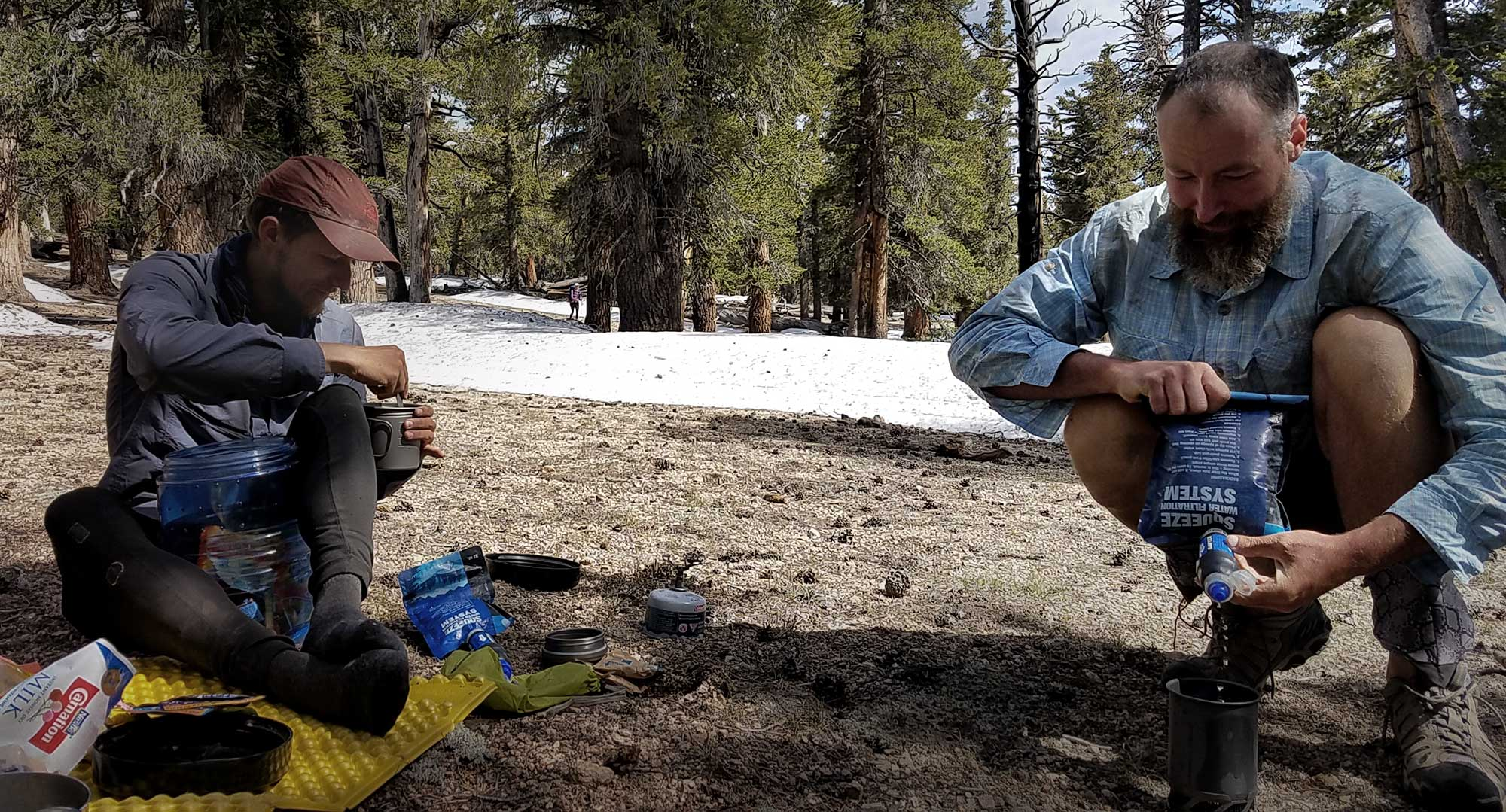 PCT hikers filtering water with Sawyer Squeeze filters. Photo by: Malin Klingsell