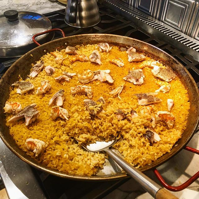 Thinking back to the last paella I made. That big stove got nice and hot; which was a great setup for paella. Arborio rice, homemade seafood stock, rockfish, shrimp, all cooked in a pan that @saystreet gave me 👍🏻🥰