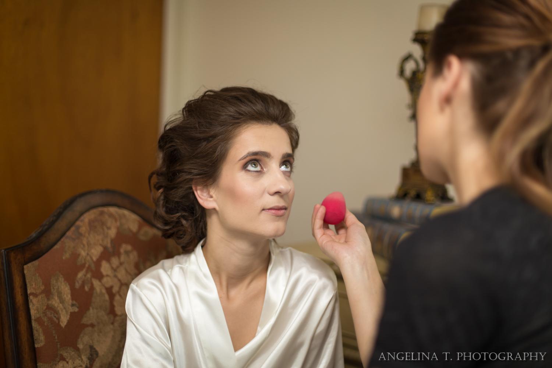 sacramento wedding photographer bridal getting makeup done
