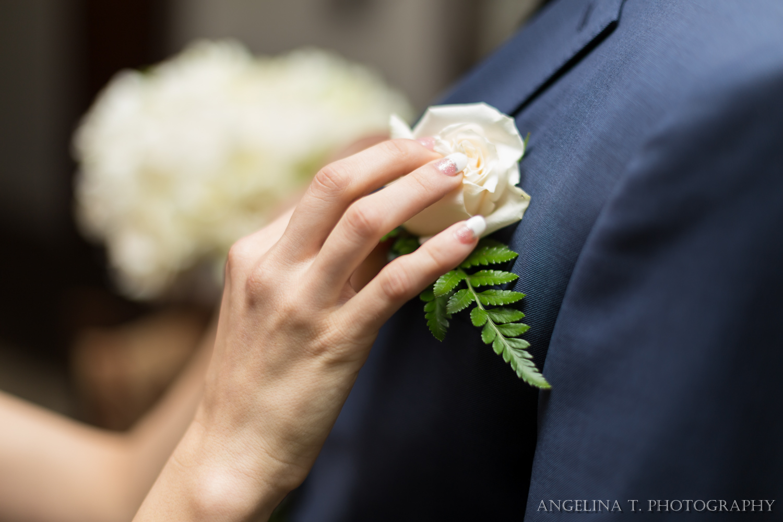 sacramento wedding photographer attaching groom's boutonniere