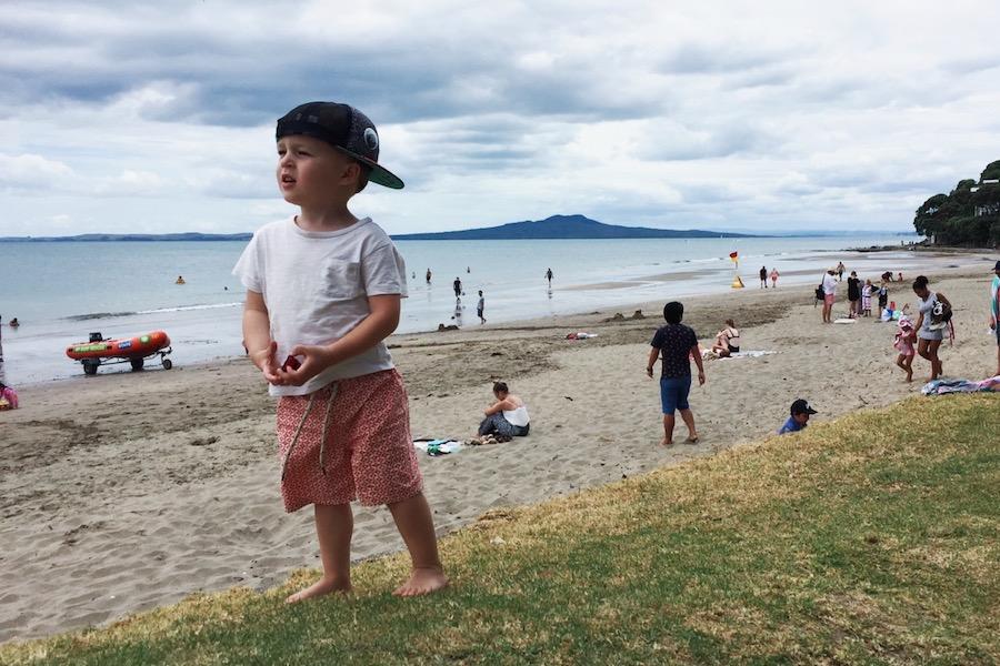 Finn (2) at Mairangi Bay Beach on New Year's Day